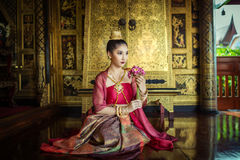Women dressed in traditional Thai dress. Stock Photo