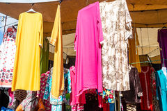 Women dresses for sale in a moroccan open space market Royalty Free Stock Image