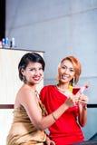 Women drinking cocktails in fancy bar Stock Image
