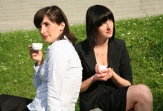 Women drinking coffee. Business women enjoy morning coffee Stock Photos