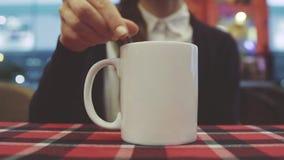 Women drinking coffee in cafe. Female stir hot drink. stock video footage