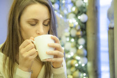 Women drinking coffee. Woman drinking tasty coffee, with closed eyes Royalty Free Stock Photos