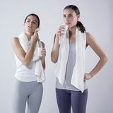 Women drinking  after effort Royalty Free Stock Photo