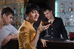 Women drinking at a pub counter Royalty Free Stock Photography