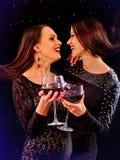 Women drinking red wine and dancing on nightclub. Lesbian women in black dress drinking red wine and dancing on nightclub Stock Photo