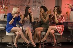 4 women drinking tequila at a bar. Royalty Free Stock Photography