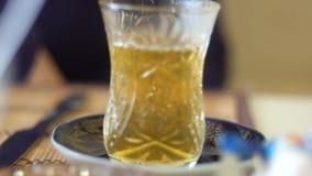 Women drinking traditional Turkish Tea. Closeup footage stock footage