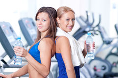 Women drinking water after sports Royalty Free Stock Photos