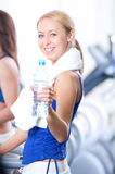 Women drinking water after sports Stock Images