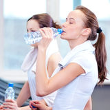 Women drinking water after sports Stock Photography
