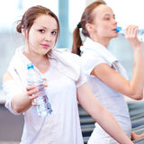 Women drinking water after sports Stock Photos