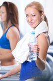 Women drinking water after sports Stock Image