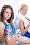 Women drinking water after sports Royalty Free Stock Photography