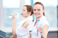 Women drinking water after sports Royalty Free Stock Photo