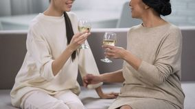 Women drinking white wine and chatting, support and communication, celebration. Stock footage stock footage