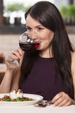 Women drinking wine. Beautiful mature women drinking wine in res Royalty Free Stock Photos