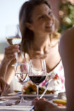Women drinking wine at patio table Royalty Free Stock Photo