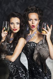 Women drinks champagne in nightclub.Merry Xmas Stock Photography