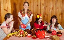 Women  drinks tea and eats pancake Stock Photography