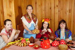 Women  drinks tea and eats pancakes Stock Photo