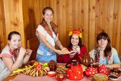 Women  drinks tea and eats pancakes Royalty Free Stock Photos
