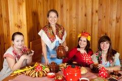 Women  drinks tea and eats pancakes Royalty Free Stock Image