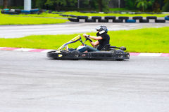 Women drive karting car on outdoor track Royalty Free Stock Photos