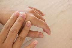 Women dry hands, apply skin care or lotion Stock Photo