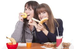 Women eating breakfast Stock Images