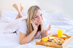 Women eating breakfast in bed Royalty Free Stock Photo