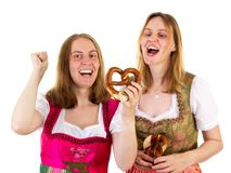 Women eating delicious pretzel Royalty Free Stock Photography