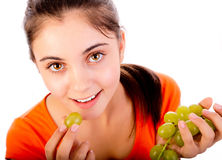 Women eating grapes Stock Images