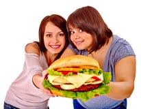 Women eating hamburger Royalty Free Stock Photos