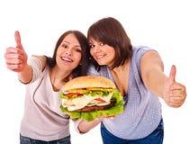 Women eating hamburger Royalty Free Stock Photography