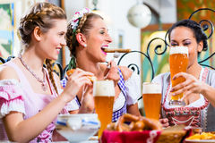 Women eating lunch in Bavarian Restaurant Stock Photo