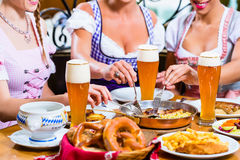 Women eating lunch in Bavarian Restaurant Royalty Free Stock Photos