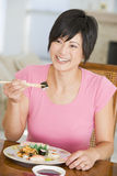 Women Eating meal, mealtime With Chopsticks Stock Photos