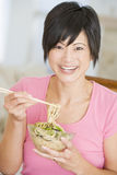 Women Eating meal, mealtime With Chopsticks Royalty Free Stock Image