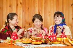 Women eating pancake during Pancake Week royalty free stock image
