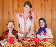Women eating pancake during  Shrovetide Stock Photo