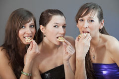 Women eating pizzas royalty free stock image