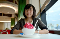 Women eating shaved ice Stock Images