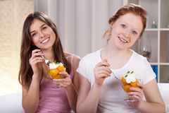 Women eating tasty dessert Royalty Free Stock Images
