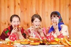 Women eats pancake Stock Photos