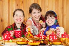 Women eats pancake with caviare royalty free stock photography