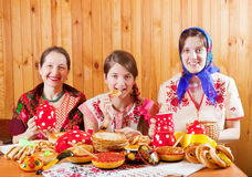 Women eats pancake  during  Shrovetide Stock Photo