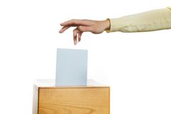 Women in the election with ballots and ballot box. A young woman in an election shall deliver their vote. Ballot at the polling station Royalty Free Stock Photo