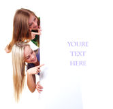 Women and empty banner. Two women with big white empty banner Royalty Free Stock Photography
