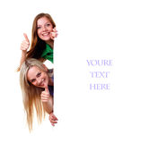 Women and empty banner. Two women with big white empty banner Stock Photos