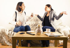Women engaged in conversation. Women engaged in animated conversation over tea Royalty Free Stock Images